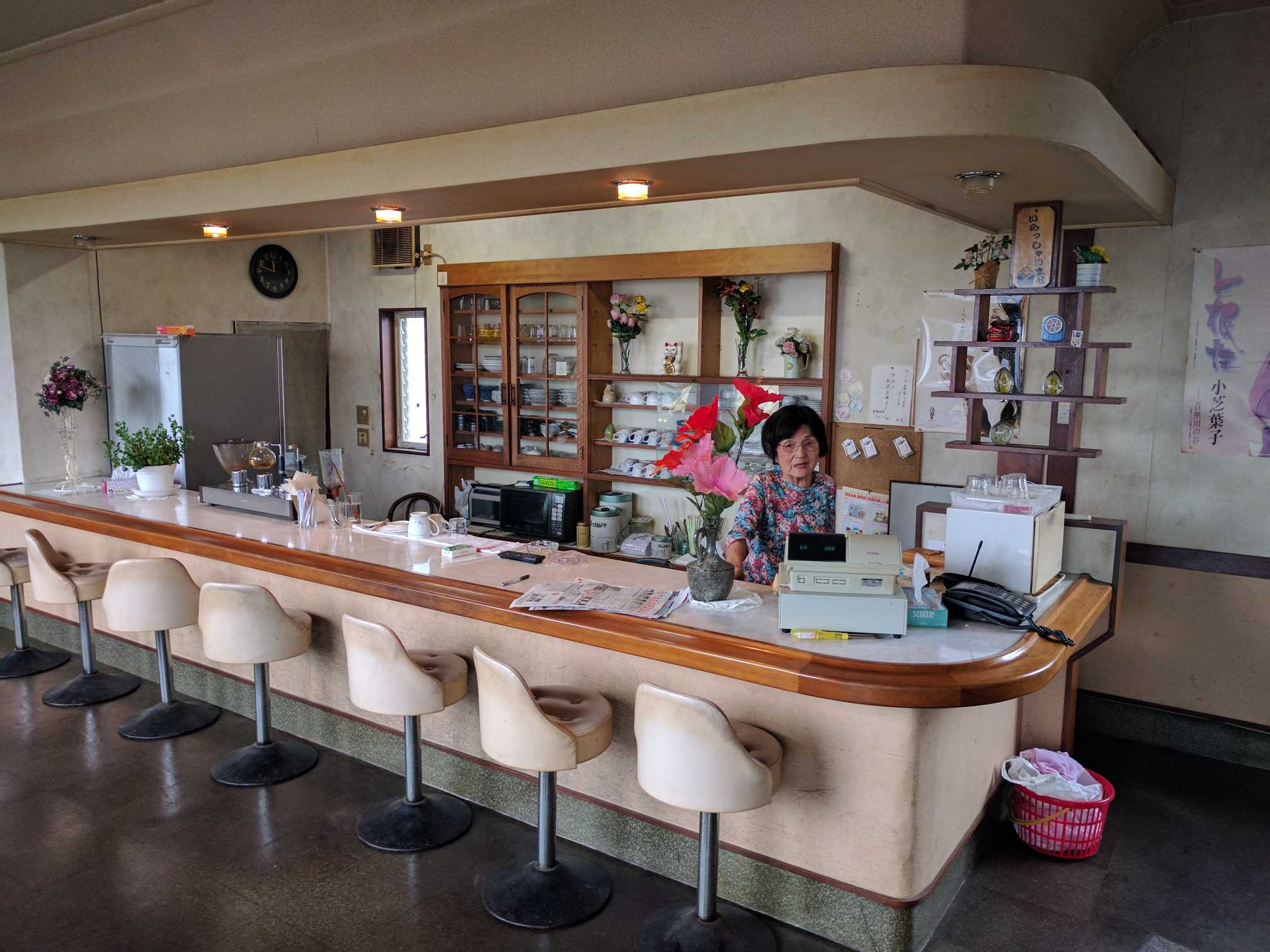 The owner of Wakou Cafe behind her counter